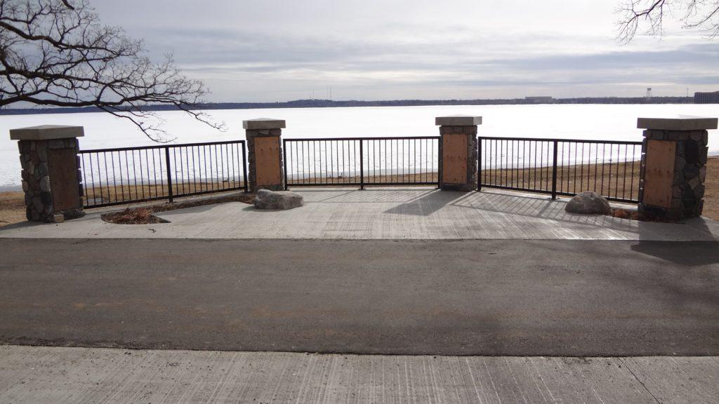 Fence railings along Lake Bemidji coated in black