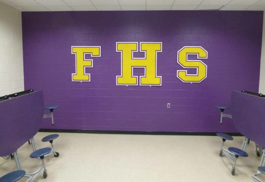 Signage for Falls High School in International Falls