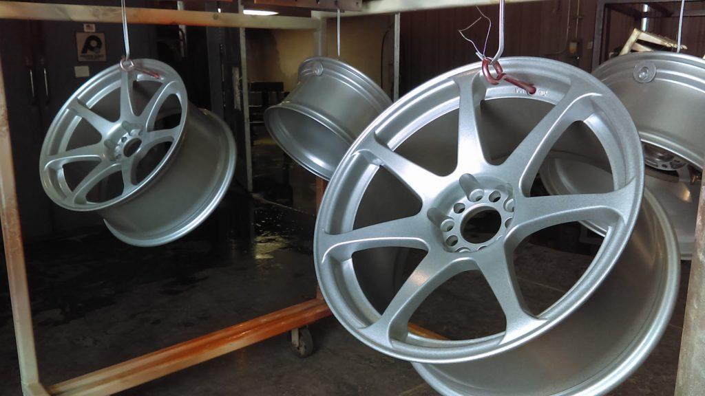 Automotive rims coated in a semi-gloss silver