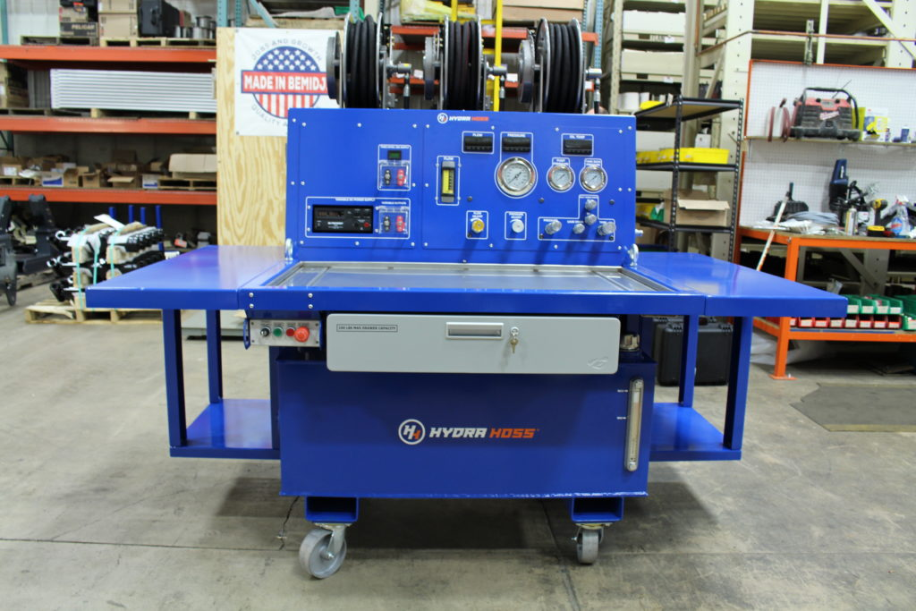 Industrial client LaValley Industries coats hydraulics testing bench in blue