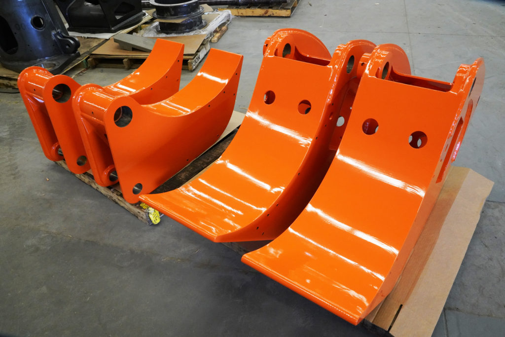 orange powder coated jaws for pipehandling equipment