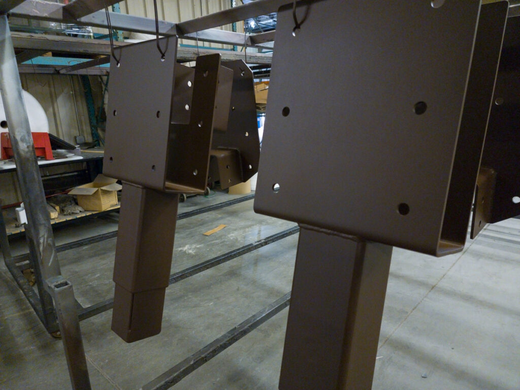 Roof truss brackets with a rust-colored coating