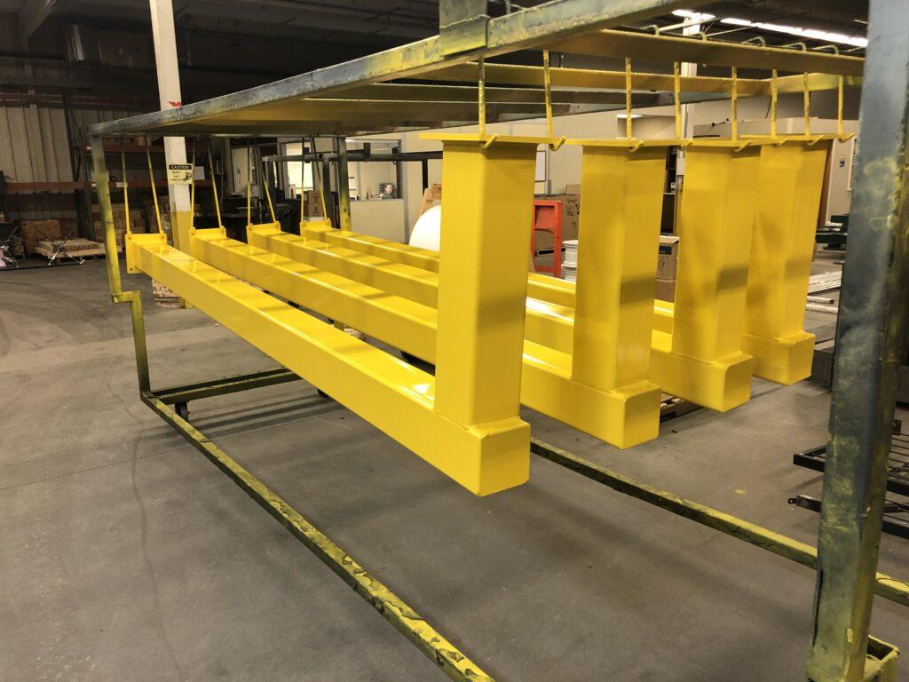 Heavy duty steel railings coated in safety yellow