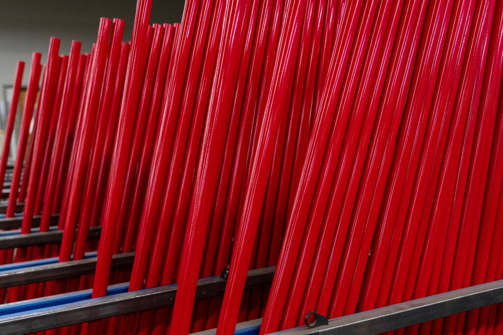 Rows of powder coated Ultimate Scrapers ready for assembly